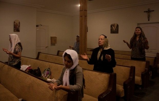 Egyptian Coptic Christians pray during a service at St. Mary of Egypt Coptic Orthodox Church in Newhall, Calif.,October 2011