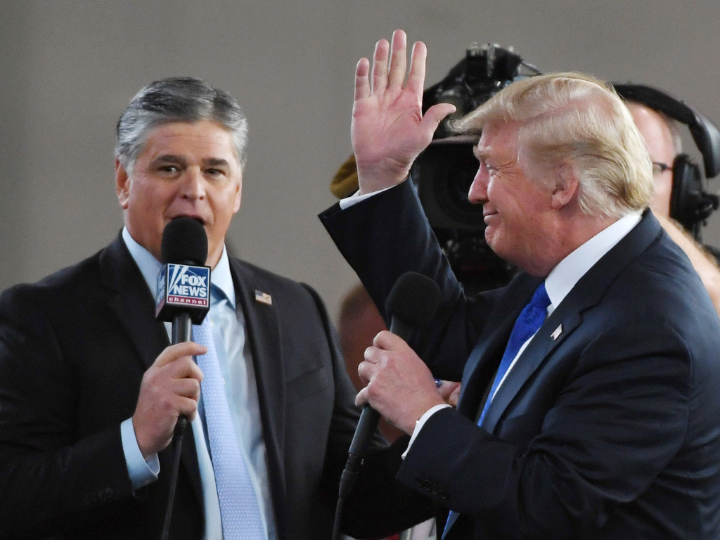 Fox News Channel and radio talk show host Sean Hannity interviews President Trump in Las Vegas in 2018. Hannity, like Trump, has cast doubt on the 2020 election results without providing evidence.