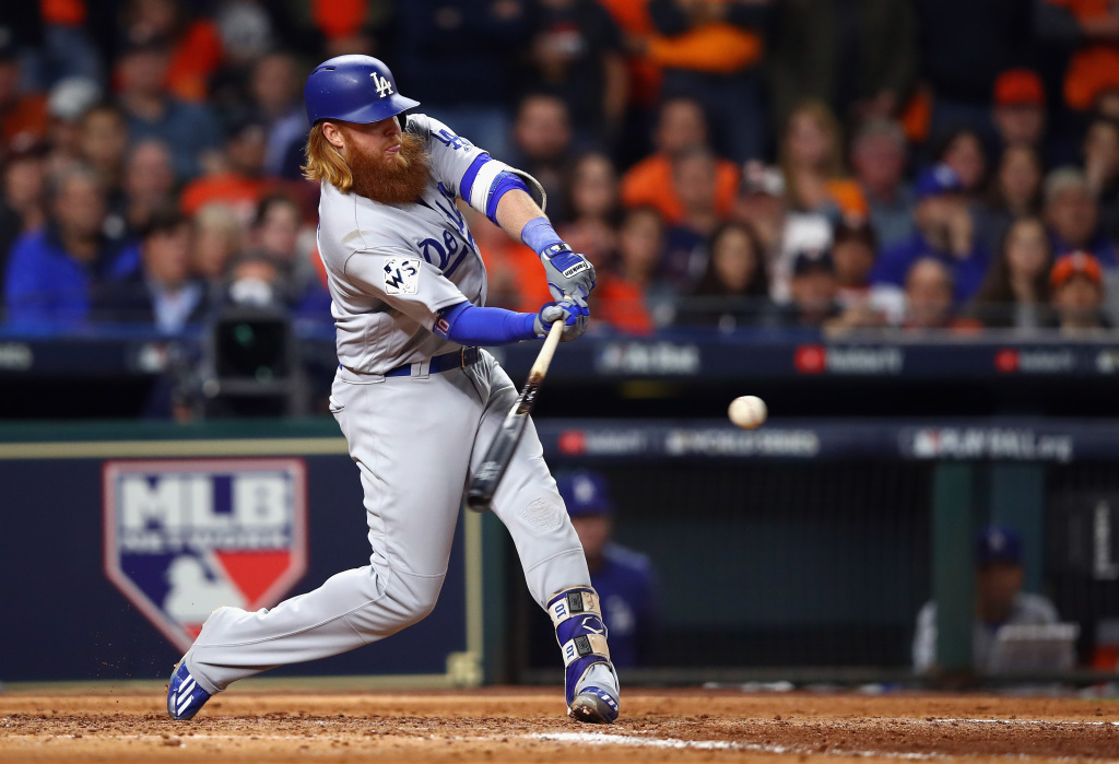 Justin Turner (#10) of the Los Angeles Dodgers hits a double during the sixth inning against the Houston Astros in Game 3 of the 2017 World Series on October 27, 2017 in Houston, Texas.