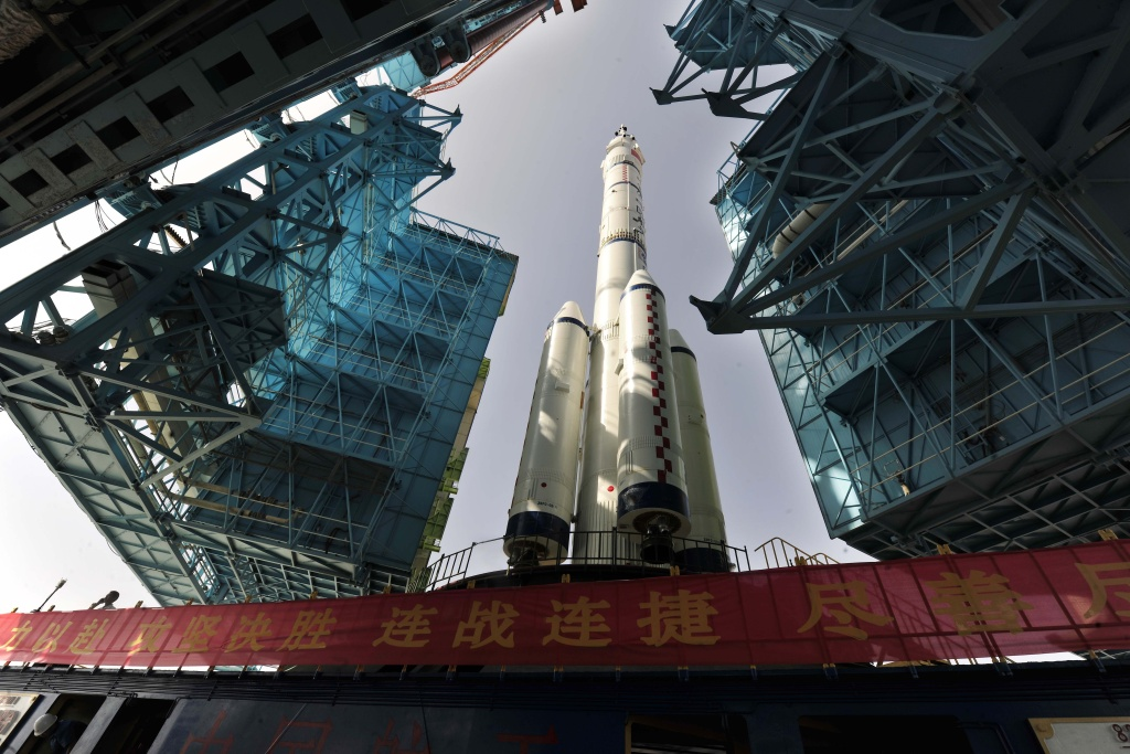 The Shenzhou X spacecraft carried by a Long March-2F carrier rocket is installed at the launch pad in Jiuquan, Northwest China's Gansu province in the morning of June 3, 2013. The spacecraft will carry three astronauts to visit the Tiangong-1 space module, state media reported.