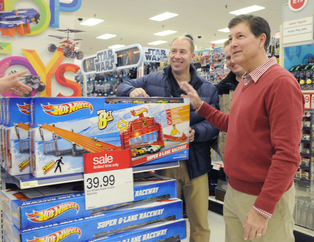 File photo: Gregg Steinhafel, Target CEO, checks out Black Friday sale items after Target opens its doors on Thursday, Nov. 22, 2012 in Bloomington, Minn.