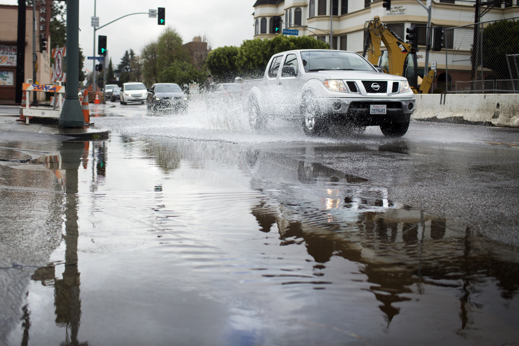 Rainwater floods Coldwater Canyon Avenue and Moorpark Street in Studio City on Friday morning, Feb. 28 after an overnight storm in Southern California. Los Angeles saved 87 million gallons of water during March 2014 storms by turning off the hose.