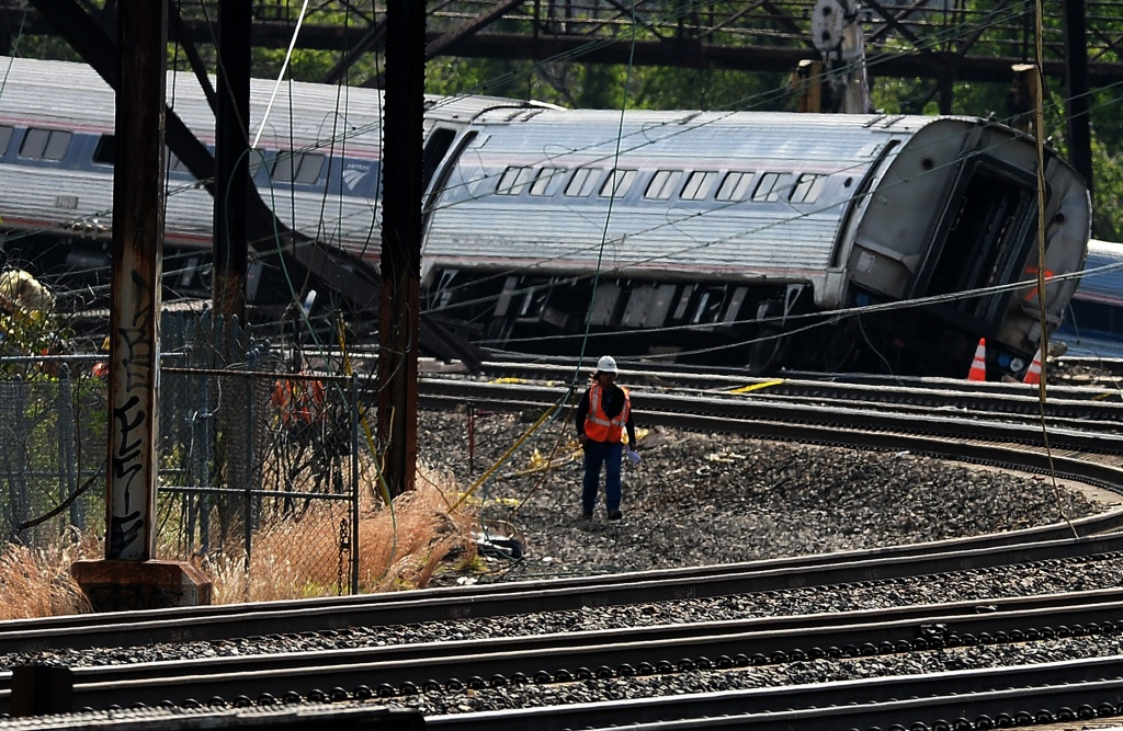 Workers at the scene of an Amtrak train derailment in Philadelphia, Pennsylvania, on May 13, 2015. Rescuers combed through the mangled wreckage of a derailed train in Philadelphia after an accident that left at least six dead, as the difficult search for possible survivors continued.