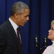 U.S. President Barack Obama stands with Lilly Ledbetter on the 7th Anniversary of the Signing of the Lilly Ledbetter Fair Pay Act, at the White House January 29, 2016 in Washington, DC.