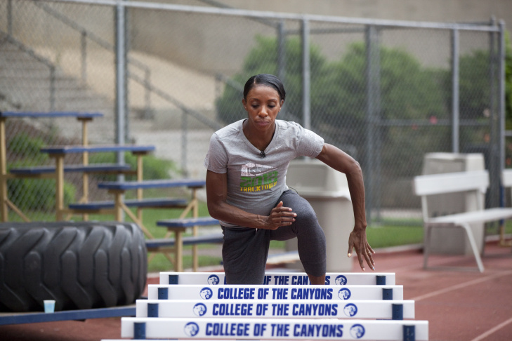 Santa Clarita, CA: July 13, 2012 - Lashinda Demus runs on the track, during a morning training session, weeks before heading to the 2012 Summer Olympics.