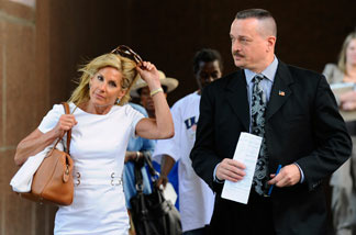 File photo: Jamie McCourt leaves the Los Angeles County Superior Court for lunch with a bodyguard after the start of her non-jury divorce trial on August 30, 2010 in Los Angeles, California.
