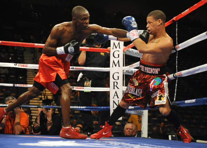Cornelius Lock (L) of the US knocks down
