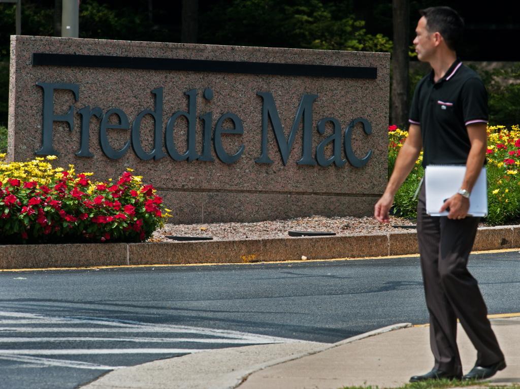 An unidentified man walks from the Freddie Mac offices on August 11, 2010,  in McLean, Virginia.