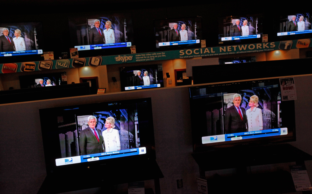 Dozens of televisions display a political advertisement with the image of former Speaker of the House and GOP presidential candidate Newt Gingrich and his wife Callista Gingrich at the American furniture electronics and appliances store December 27, 2011 in Urbandale, Iowa.