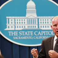 Governor Jerry Brown speaks to reporters at the State Capitol in Sacramento.