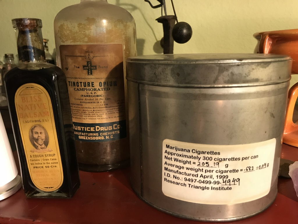 Lonnie Painter collects antique opioid- and cannabis-based tinctures. The large tin is from an experimental federal program that provides marijuana pre-rolls to selected patients around the country.