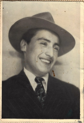 Ray poses in a photobooth in the 1940's.