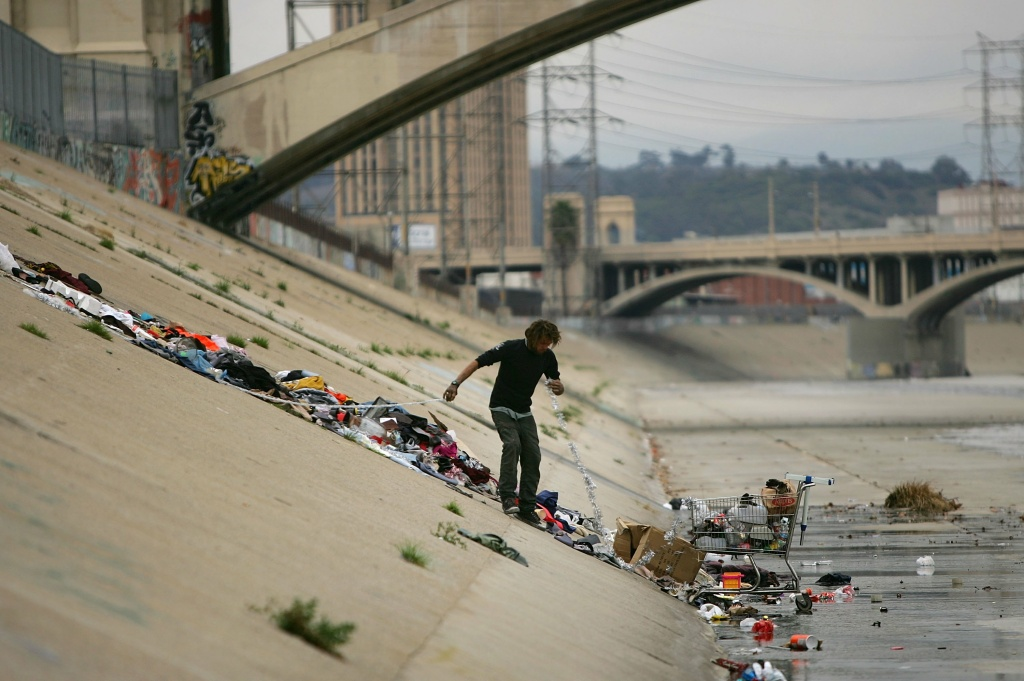 A challenge in Los Angeles County is how to warn and relocate homeless people who are living in river bottoms in the path of El Nino's potential stormwater.