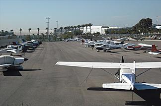 A row of planes at Santa Monica Airport.