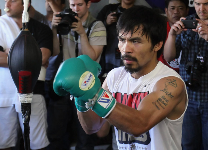Manny Pacquiao of the Philippines trains on the speed bag during a media workout at the Wild Card Boxing Club on April 20, 2011 in Hollywood, California.