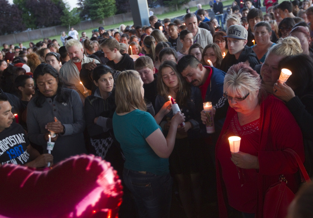 Friends, family and well-wishers hold candles for Emilio Hoffman, the victim of a school shooting at a vigil on June 10, 2014 in Troutdale, Oregon.