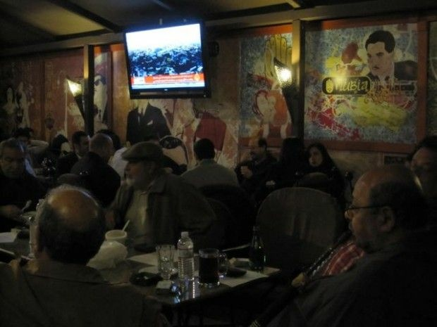 Patrons watched Al Jazeera updates from Egypt last night at the Nubia Cafe in Anaheim, February 10, 2011