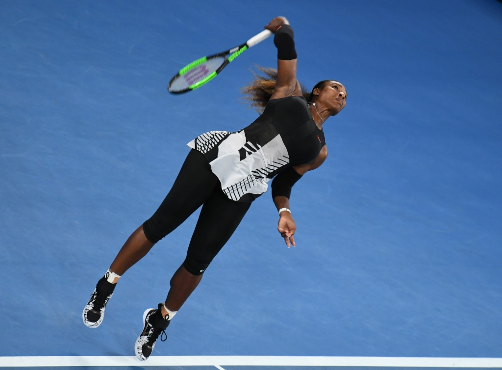 Serena Williams of the US serves against Venus Williams of the US during the women's singles final on day 13 of the Australian Open tennis tournament in Melbourne on January 28, 2017.
