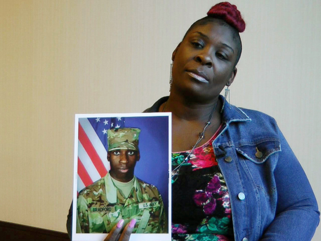 April Pipkins holds a photograph of her deceased son, Emantic