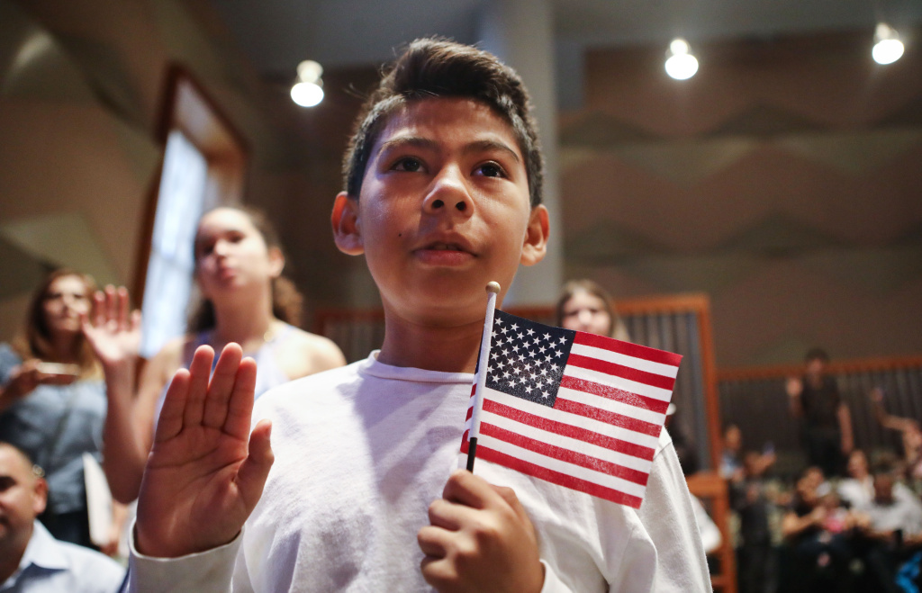 New U.S. citizen Davies Garcia, 11, originally from Mexico, holds an American flag during a naturalization ceremony conducted by U.S. Citizenship and Immigration Services (USCIS), on September 14, 2018 in Los Angeles, California.