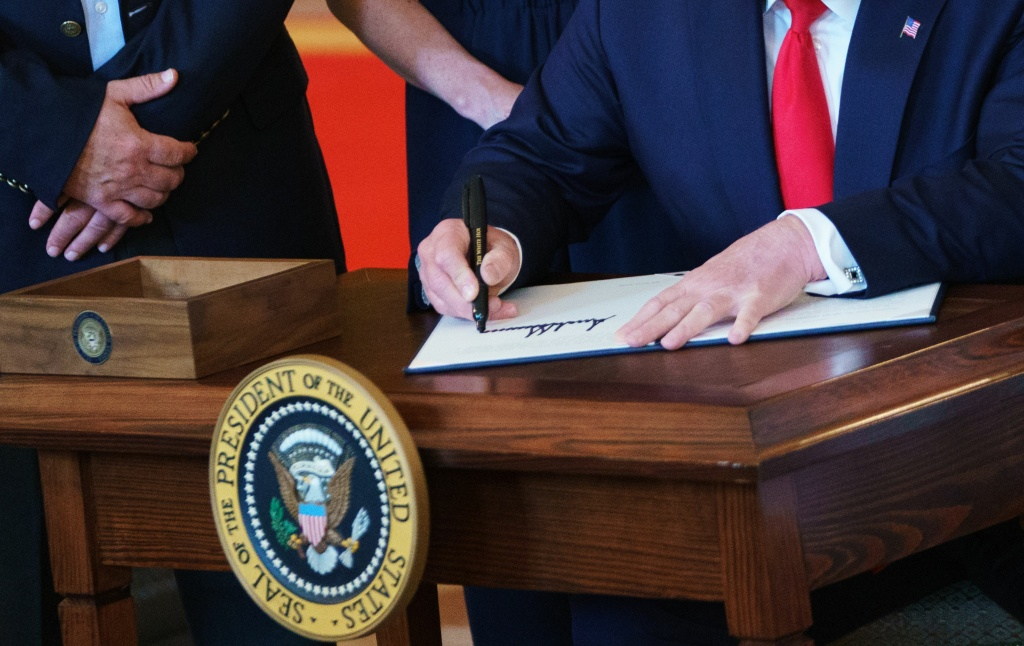 US President Donald Trump signs an executive order
