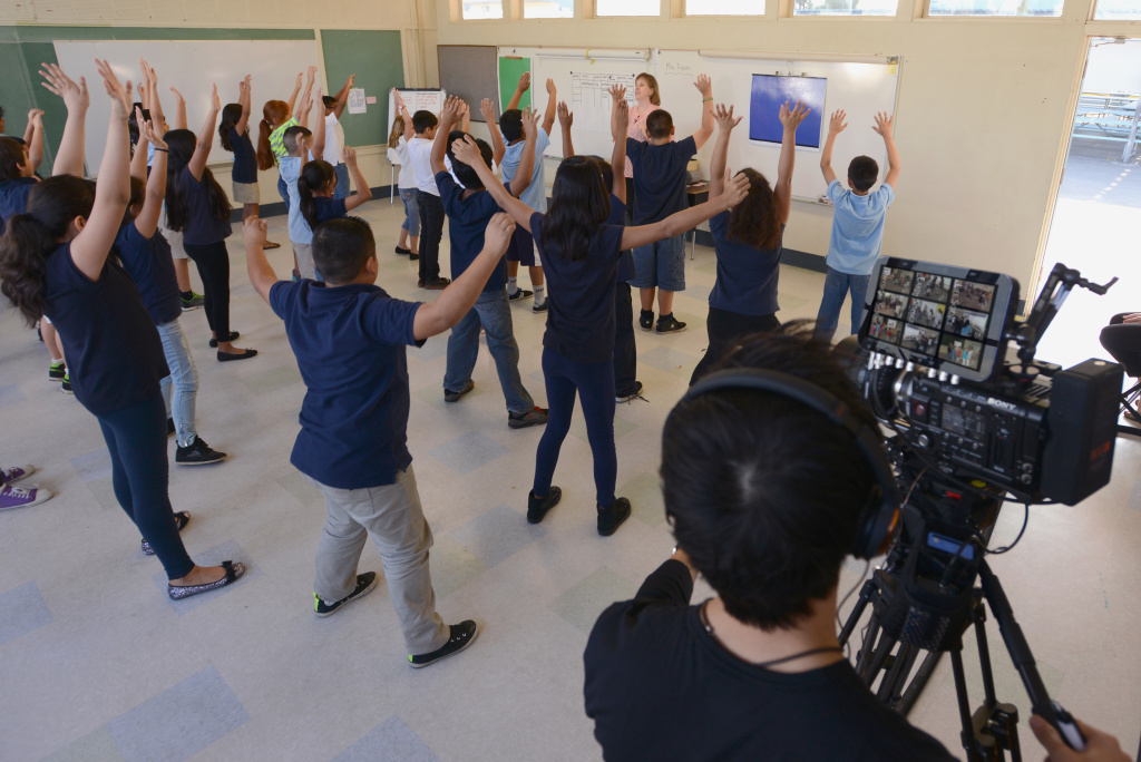 Fourth-graders at West Orange Elementary warm up with teaching artist Dawn Dyson-Platero before an arts and sciences dance lesson on weathering and erosion. The lesson is part of a new project funded by the National Science Foundation.