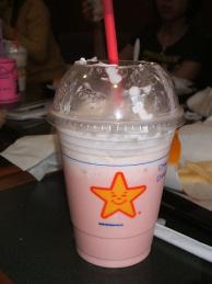 A tasty Carl's Jr milkshake, mid-gulp.