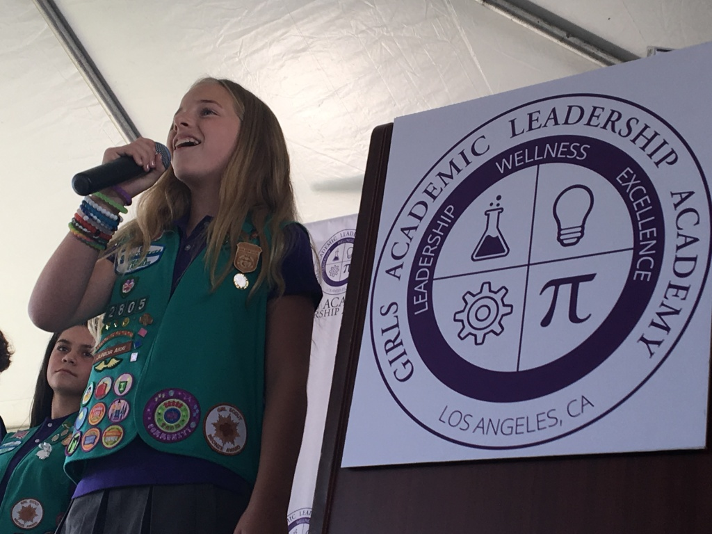 A student from the first class of Girls Academic Leadership Academy (GALA), the first non-charter single-sex school for traditional public school students to open in California in 20 years, sings the national anthem during a ribbon-cutting ceremony on Friday, Aug. 12.