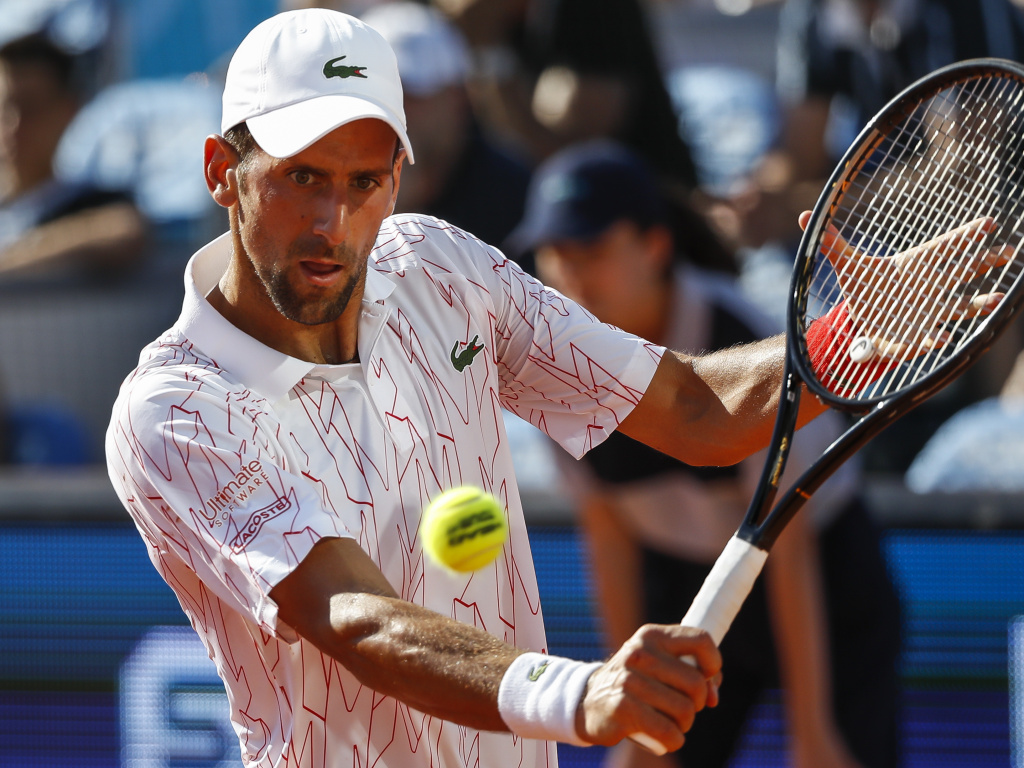 Serbian tennis star Novak Djokovic, 33, says he's not currently showing any symptoms after testing positive for the coronavirus.