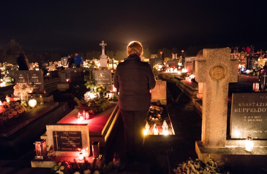 People visit a cemetery to pay respects to their ancestors on All Saints Day in the northern Slovakian village of Bobrovec on November 1, 2016.