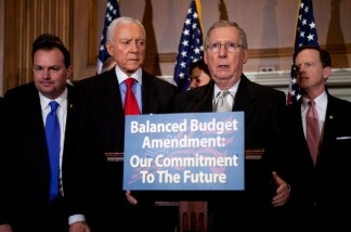 Sen. Mike Lee (R-UT), Sen. Orrin Hatch (R-UT), Senate Minority Leader Mitch McConnell (R-KY), Sen. Pat Toomey (R-PA) (L-R), and other Senate Republicans hold a news conference to announce a proposed balanced budget amendment to the Constitution on March 31, 2011.