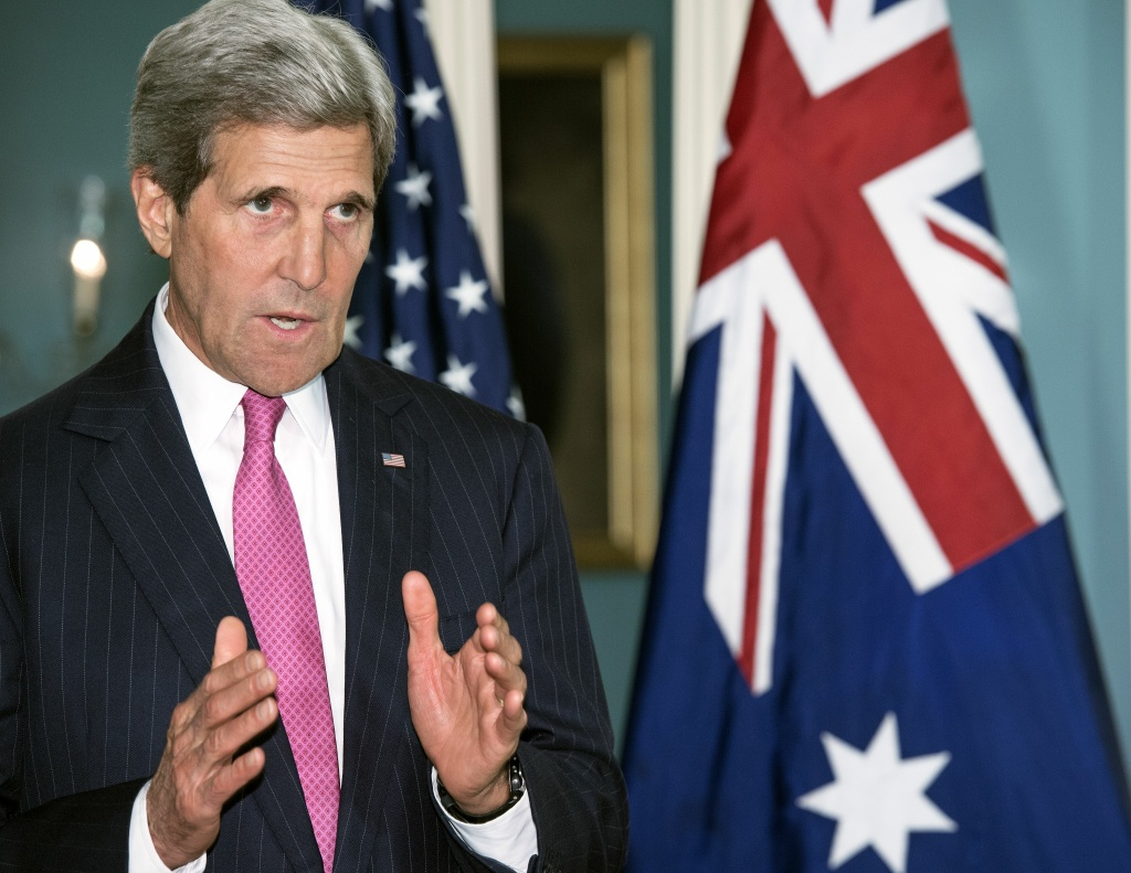 "US Secretary of State John Kerry speaks on Iraq during a photo opportunity with Australian Prime Minister Tony Abbott shortly before the two had a private meeting on June 12, 2014 at the US Department of State in Washington, DC. Kerry said Monday that Washington is ""open to discussions"" with Tehran if the Iranians can help end the violence and restore confidence in the Iraqi government."