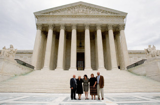 WASHINGTON - SEPTEMBER 08: U.S. Supreme Court Associate Justice Sonia Sotomayor (C) poses with her mother Celina (L), stepfather Omar Lopez (2nd L), sister-in-law Tracey (4th L), and brother Juan (R) during a photo-op after an investiture ceremony at the U.S. Supreme Court September 8, 2009 in Washington, DC.