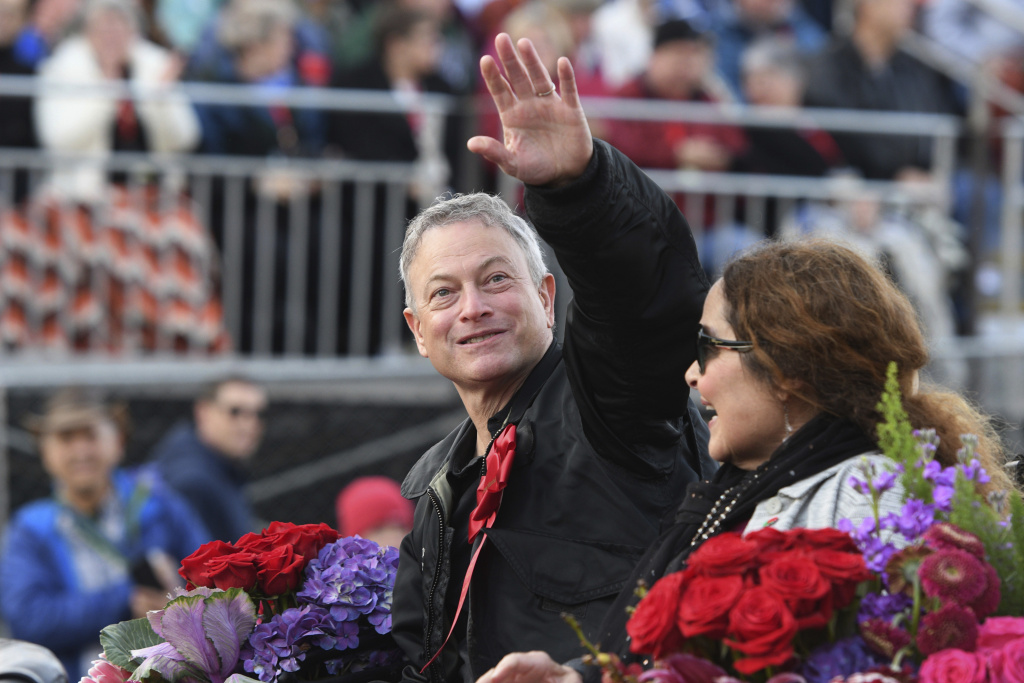 Grand Marshal Gary Sinise waves to the crowd at the 129th Rose Parade in Pasadena, Calif., Monday, Jan. 1, 2018.