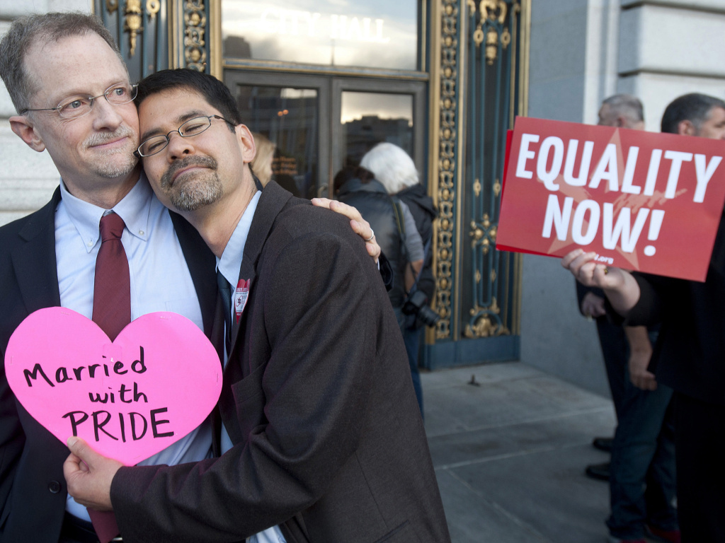 John Lewis (left) and Stuart Gaffney embrace outside San Francisco's City Hall shortly before the U.S. Supreme Court ruling cleared the way for same-sex marriage in California in June.