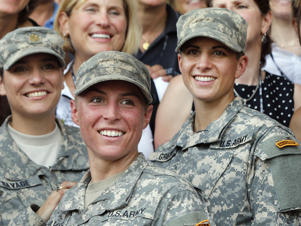 Army 1st Lt. Shaye Haver, center, and Capt. Kristen Griest, right, pose for photos with other female West Point alumni after an Army Ranger school graduation ceremony at Fort Benning, Ga, in 2015. They were the first two women to graduate from U.S. Army Ranger school.