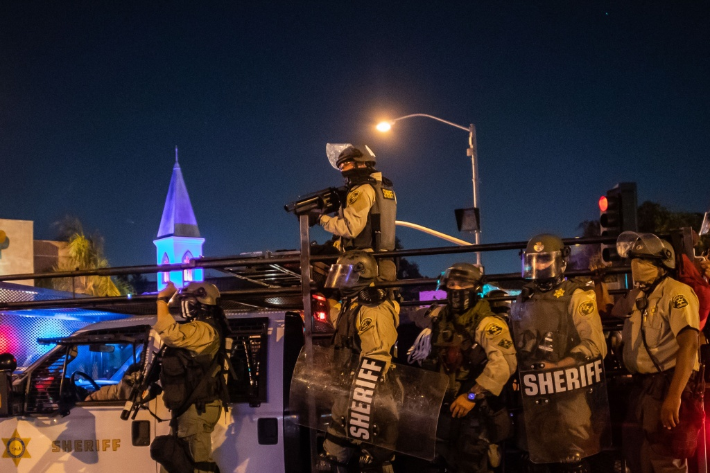 Los Angeles County Sheriff officers disperse demonstrators protesting over the lack of criminal charges in the police killing of Breonna Taylor in West Hollywood, California on September 25, 2020.