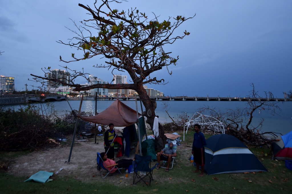 A group of homeless people live under a tree next to Laguna del Condado, in San Juan, Puerto Rico, on September 30, 2017.