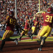 Southern California players celebrate a touchdown scored by cornerback Adoree' Jackson (2) during the first half of an NCAA college football game against UCLA, Saturday, Nov. 28, 2015, in Los Angeles. (AP Photo/Jae C. Hong)