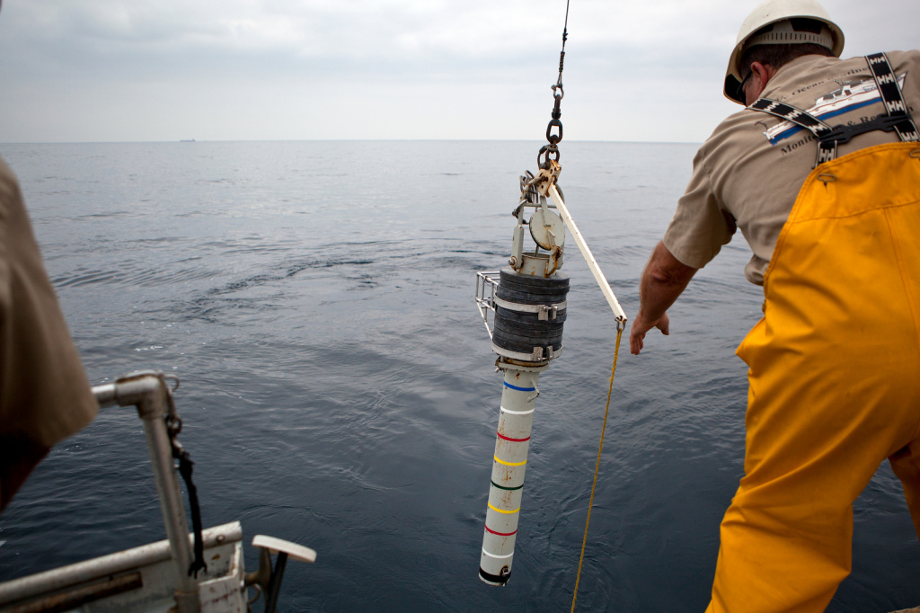 A core is lowered into the water to gather a sediment samples from the Palos Verdes peninsula.