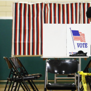 The polls are open in New Hampshire. A voter marks his ballot in the first-in-the-nation presidential primary Tuesday.