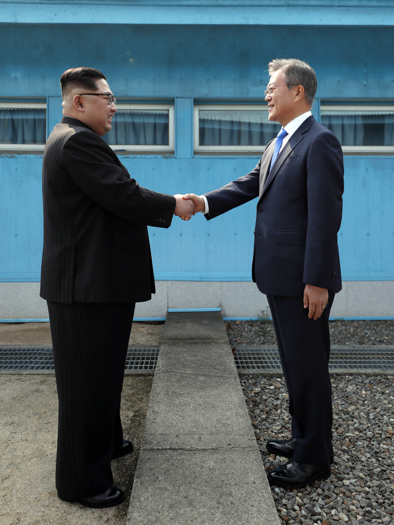 North Korean Leader Kim Jong Un, left, and South Korean President Moon Jae-in shake hands over the military demarcation line upon meeting for the Inter-Korean Summit on April 27, 2018 in Panmunjom, South Korea.