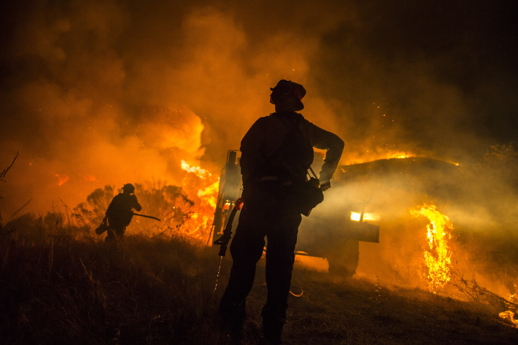 King River Hotshots and Vandenberg Air Force Base firefighters conduct a defensive firing operation off El Capitan Canyon Rd late Thursday night to protect structures in the path of the Sherpa Fire.