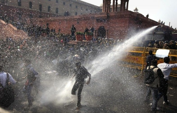 A water cannon targets protesters during their march towards the Presidential Palace in New Delhi, India, on Saturday.