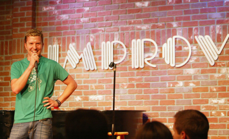 Jamie Flam on stage as part of the Spanglers show at the Improv Comedy Lab.