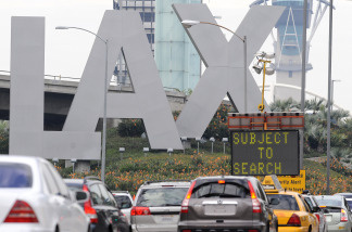 File photo: Traffic backs up at a security checkpoint near the entrance to Los Angeles International Airport on December 26, 2009.