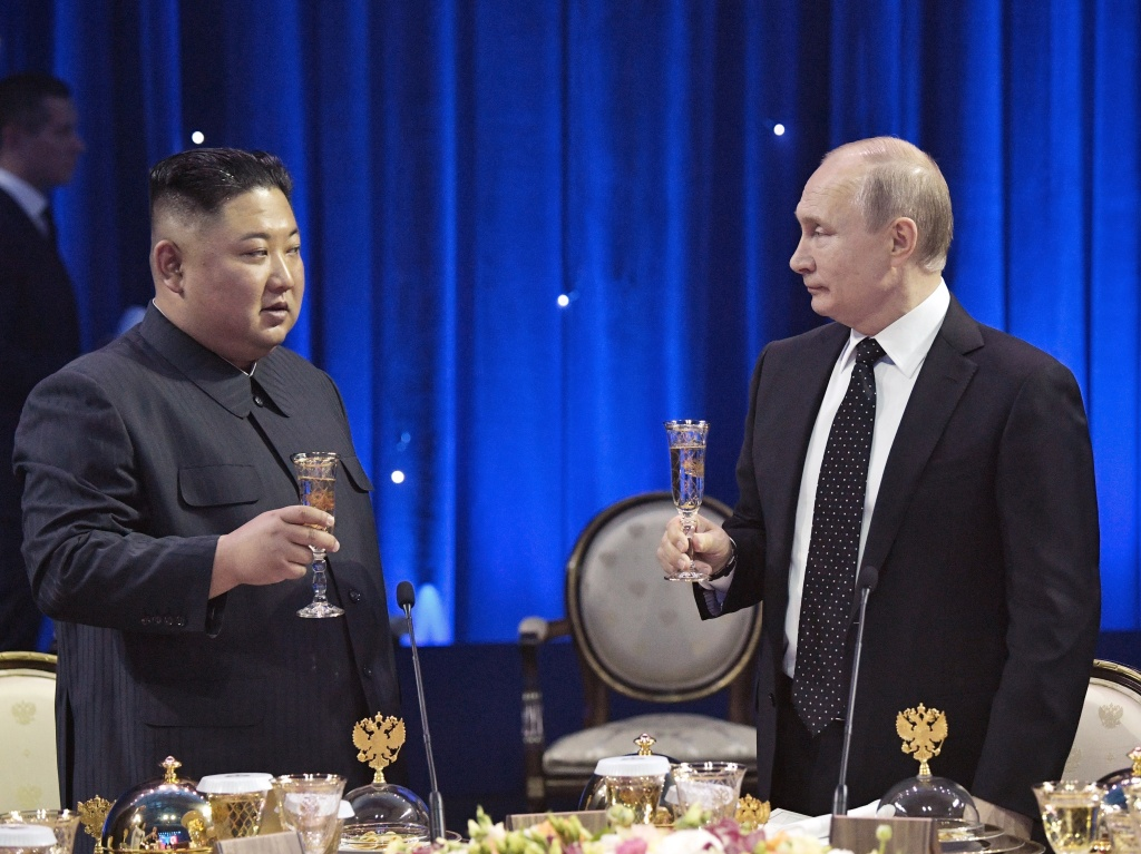 Russian President Vladimir Putin, right, toasts with North Korea's leader Kim Jong Un after their talks in Vladivostok, Russia, on Thursday.