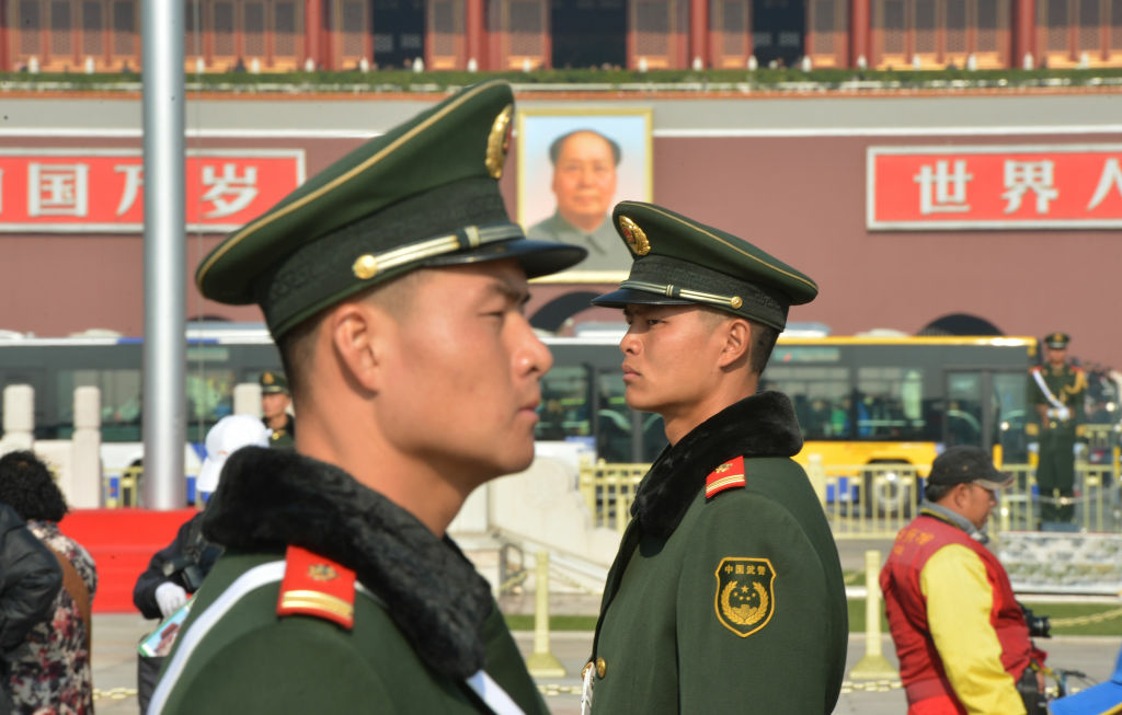 Chinese paramilitary police stand guard in front of the portrait of late leader Mao Zedong at Tiananmen Square in Beijing on November 6, 2012. The heirs of Mao Zedong convene this week to anoint China's next leaders, as the Communist Party maintains an iron grip on the economic powerhouse despite mounting calls for change in the Internet era.