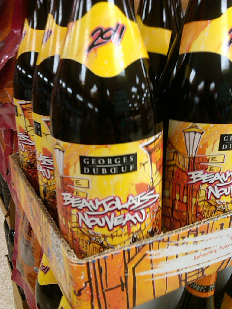Is has arrived! And this time, the Beaujolais Nouveau gets a rad street art label. Move over, flowers and colorful abstractions! Wine marketing marches on!
