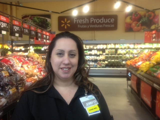 Jennifer Gonzales, manager of the Walmart Neighborhood Market in Altadena, in the store's fresh produce section.